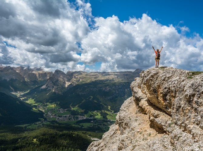 A man at the top of the mountain